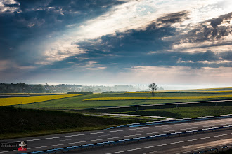 Photo: Alone in the dark.  This is south-east Poland  #stormphotography  #landscape #landscapephotography #highway #blue #green #yellow #tree #sky #skyphotography #clouds