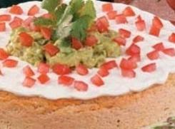 To serve, remove sides of pan.  Garnish with guacamole in center and sprinkle...