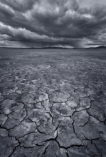 Photo: The Alvord Desert, in a remote section of southeastern Oregon, is one great place to spend a weekend exploring. The expansive playa has all kinds of variety and we were fortunate to find many different patterns and textures (including some water and ice - coming soon!). Although there was little color in the sky on this particular morning, these dark and dramatic clouds were great to photograph.