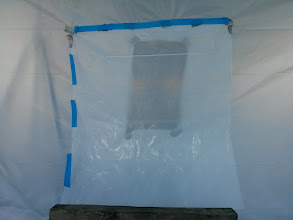 Photo: After re-reinforcing the corners of the access hole with duct tape, We sealed the access hole in tent with flap of plastic sheeting.