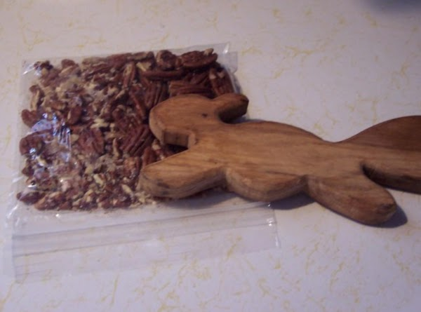 Preheat oven to 300F. Gather the children and your Holy Bible.  Place pecans in the plastic...