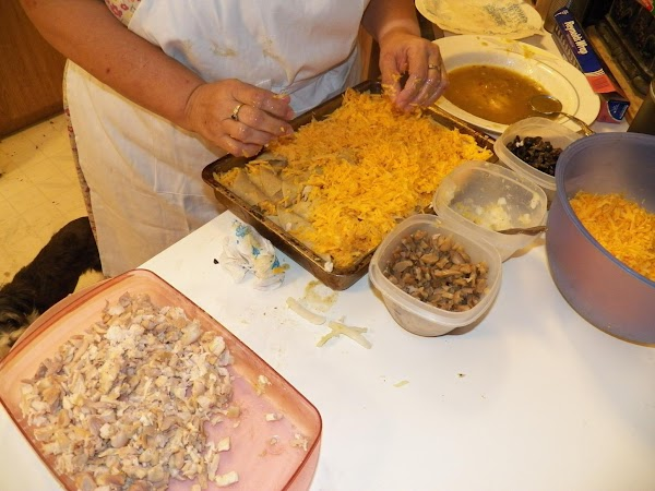 Place tortillas into the baking pan. Holding one side, let the other rest on...