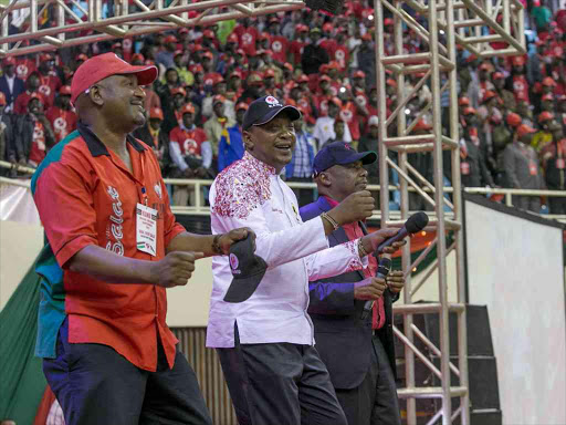President Uhuru Kenyatta join KANU Party leader Gideon Moi and Secretary Nick Salat in a jig during the Party's National delegates where they endorsed his Presidential Candidature for the August 2017 General Elections at Moi Sports Centre Kasarani, Nairobi County.