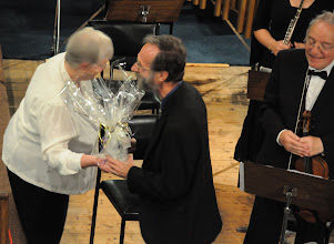 """Photo: Christopher Marshall, composer of """"For What Can Be More Beautiful?"""", is presented with a tribute."""