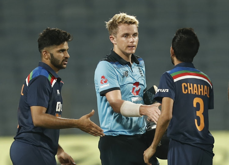 England's Sam Curran shakes hands with India's Yuzvendra Chahal after the match at Maharashtra Stadium in Pune, India, March 28 2021. Picture: REUTERS/FRANCIS MASCARENHAS