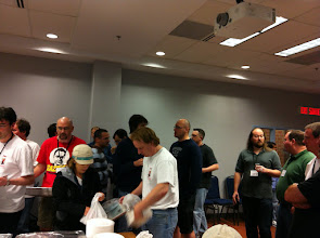 Photo: The DevSummit dinner food (Thai) is brought into the hacking lounge.