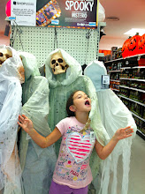 Photo: Lauryn came with me (she was off school all week) and she insisted on going to look at the Halloween decorations. Since we had some time to kill, we headed downstairs (yes... this K-Mart is 2 levels) and found some spooky skeletons.