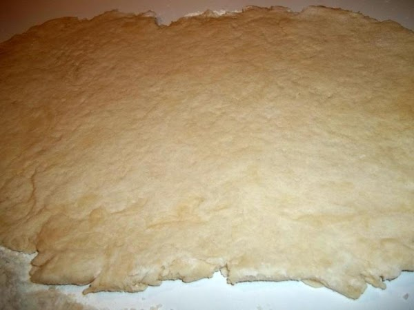 On a lightly floured surface, knead the dough until smooth.  Roll the dough into a...