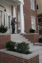 Photo: October 2006 - Month 38: Laura's cousin Dean Evans, who designed and fabricated all of the metal railings throughout the house, installing the side railings on the porch.