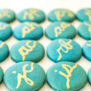 Gold and Teal Monogram Macarons.