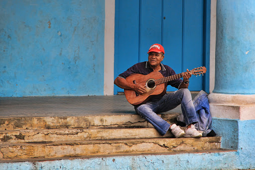 A musician performs for passersby in Havana, Cuba.