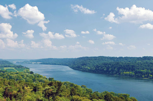 Passengers onboard the Queen of the Mississippi will appreciate the peaceful, green scenery as the ship sails on the Ohio River.