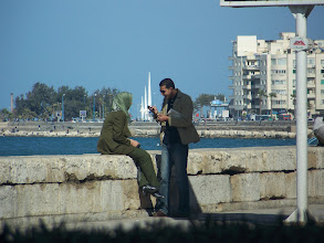 Photo: A couple along the road in Alexandria.