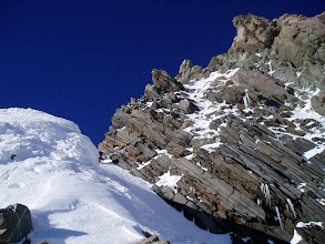 Photo: The Summit Rocks. Our route is roughly up the snow and ice - and it's much worse in reality than it looks here!