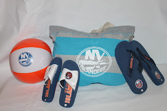 Photo: Beach Collection: Enjoy the beach with an Islanders beach ball, beach bag, and flip flops. (Sold separately)