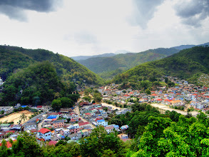 Photo: Mae Sai & Tachilek #TravelThursday :- If you look carefully in this shot you'll notice a river winding through the mountains that appears to divide a town into two halves. In actual fact it defines a border between two countries. What you see here is the town of Mae Sai in Thailand on the left hand side of the river and the town of Tachilek in Myanmar (formerly Burma) on the right hand side of the river.  Photography by Justin Hill ©