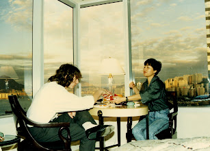 Photo: DC takes solid food! Sally coaxes DC the Mullet Boy out of the 1980's with a snack @ the Renaissance Harbour View, HK 1990