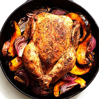 Cast-Iron Roast Chicken with Winter Squash, Red Onions, and Pancetta.