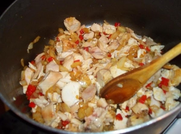 Drain fat, leaving 2 tablespoons in the pan.  Add chicken and cook over...