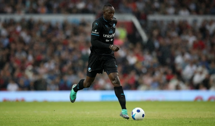 Usain Bolt controls the ball during the Soccer Aid for UNICEF 2018 match between England and The Rest of the World at Old Trafford on June 10, 2018 in Manchester, England.