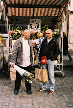 Photo: Two Men with Shaved Heads in Front of a Flower Stand #streettogs #streetphotography #Dublin #filmphotography