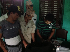 Photo: the locals are curious. for many of them, it's the first time they have seen a Laptop.