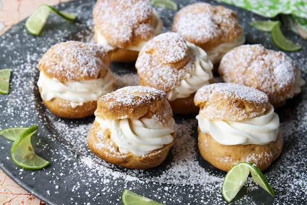 Key Lime Cream Puffs Dusted With Powdered Sugar.
