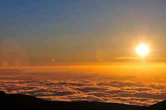 Photo: Sun dipping and cloud beneath us.