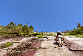 Photo: Soloing up from the grass to the next wet ledge.