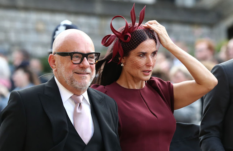 Eric Buterbaugh and Demi Moore arrive ahead of the wedding of Princess Eugenie of York to Jack Brooksbank at Windsor Castle.