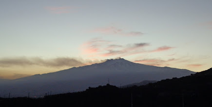 Photo: Etna puffing out dust at sunset