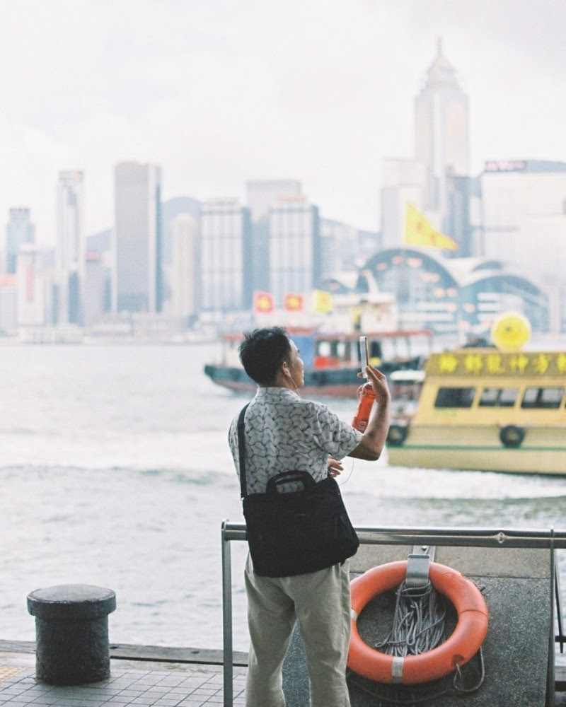 A man taking photos at star ferry