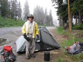 Photo: Monday July 12, 2010   The bus dropped us off in a misty fog/rain, at 6:30 or 7.  We found a campsite at the edge of a parking lot.  It rained on and off, mostly on, all night -- the first test of our new Rainshadow Tarp Tent!  Thank you Henry Shires, it worked great.