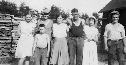 Photo: The Plaunts spent their summers at Wye, a small village on the CPR, 60 miles NW of Sudbury, along side the Spanish River and a stone throw from Lake Pogamasing. W. B. Plaunt operated a lumber mill here from 1929 to 1940. Donald with his three sisters, Helen, Kae and Marion, and three Plaunt employees.