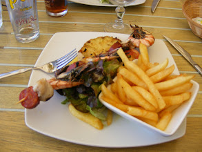 Photo: Which includes this seafood and chorizo sausage skewer, on grilled pineapple, with frites – yum!