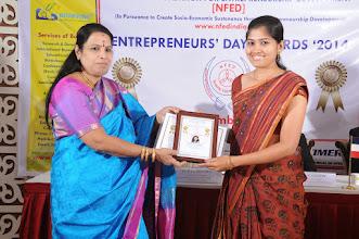 Photo: Chief Guest Dr. V. Padmavathy Issing Young Woman Entrepreneur Award to Ms. Sandhiya Loganathan, Founder & Director - Marketing, Digiteyes Marketing, Bangalore, Karnataka