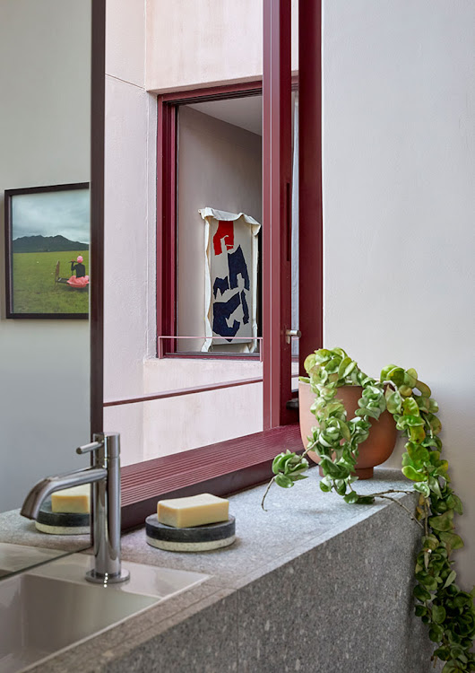 The en-suite bathroom, with artworks by Claire Johnson and Dale Lawrence.