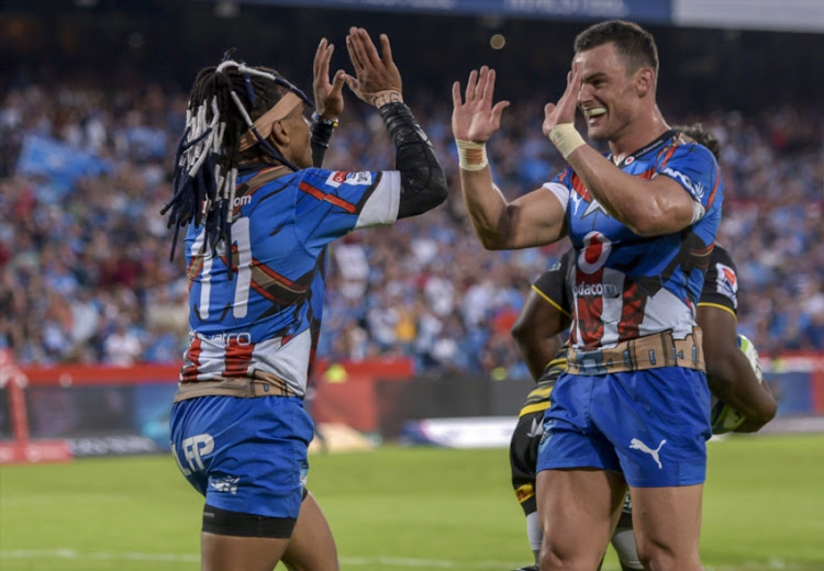Rosko Specman of the Vodacom Bulls celebrates with team mate Jessie Kriel of the Vodacom Bulls after scoring his third try during the Super Rugby match between Vodacom Bulls and DHL Stormers at Loftus Versfeld on February 16, 2019 in Pretoria, South Africa.