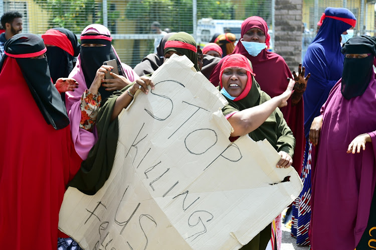 Somali nationals picket outside the New Brighton police station after several spaza shop owners were shot dead.