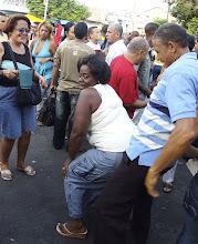 Photo: woman dances with her partner in santiago de cuba. Tracey Eaton photo.