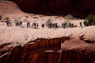 Photo: This is one of my favorite shots of the event.  The group of people are hking on what looks like a land bridge across a chasm, on the way over to Corona Arch during the Adventure Rabbi Passover in Moab Seder.