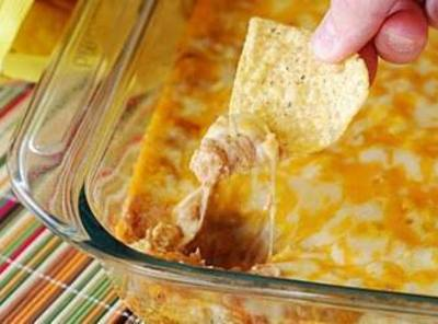 Preheat oven to 350 degrees. Mix together cream cheese and sour cream in a...