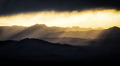 Photo: Light Shines In  On the way to Death Valley in our four wheel Kia cough cough we rented in Las Vegas +Amy Heiden, +Ricardo Lagosand I saw this scene developing on the horizon and immediately pulled over to try and capture the amazing light rays. The light coming through the clouds lighting up the hillsides was just spectacular. I was zoomed in at 200mm to get this shot. I touched it up a bit in Lightroom with some final punches made in Color Efex Pro 4.  Prints available:http://bit.ly/1tNl1ds  #godrays  #sunrays  #deathvalley