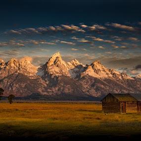 Mountain Morning by Bob Harriman - Landscapes Mountains & Hills ( field, farm, clouds, mountains, sky, grand teton mountains, abandonded, prairies, sunshine, sunrise, shadows )