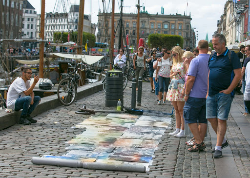 copenhagen-local-artworks.jpg - A local artist displays paintings along the canal front in Nyhavn.