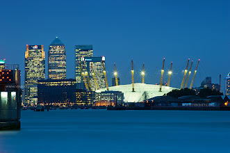 Photo: Twilight | Blue Hour View of Canary Wharf and the O2 across the Thames - London, U.K.  The lights of London often do not disappoint night photographers, and with the city's varied architecture, each displaying its own style, there are endless opportunities and many to go around. ... Canary Wharf is the financial district of London, and also known as the financial capital of Europe. Over 90,000 people work in Canary Wharf, which has 30 buildings with over 200 shops, bars and restaurants. It is also known for having UK's three tallest buildings: One Canada Square at 774 ft., followed by 8 Canada Square and the Citigroup Centre, both at 654 ft.  #CanaryWharf   #O2   #London   #England   #UK   #Travel   #Photography   © Yen Baet - www.YenBaet.com. All Rights Reserved. Join me on Facebook at www.facebook.com/YenBaetPhotography.