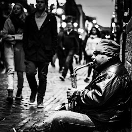 The Jazz by Jimmy Fitz - City,  Street & Park  Street Scenes ( music, black and white, street musician, saxophone, jazz, musician, rain )