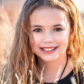 by Kathy Suttles - Babies & Children Child Portraits ( brown eyes, suttleimpressions, lil girl, reflective eyes, outdoors, half smile, portrait,  )