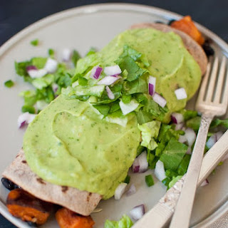 Sweet Potato Burrito Smothered in Avocado Salsa Verde.