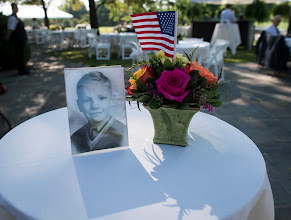 Photo: A photograph of Neil Armstrong as a young man is displayed on a table during a memorial service celebrating the life of Armstrong, Friday, Aug. 31, 2012, at the Camargo Club in Cincinnati. Armstrong, the first man to walk on the moon during the 1969 Apollo 11 mission, died Saturday, Aug. 25. He was 82. Photo Credit: (NASA/Bill Ingalls)